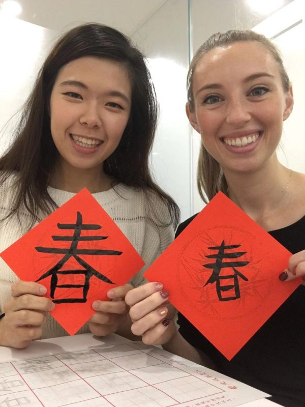 Ehana with her student practicing Chinese