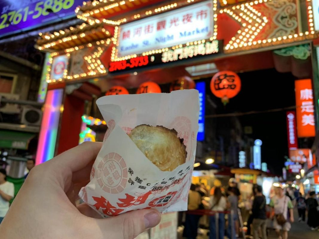 Enjoying a Hu Jiao Bing at Raohe Night Market